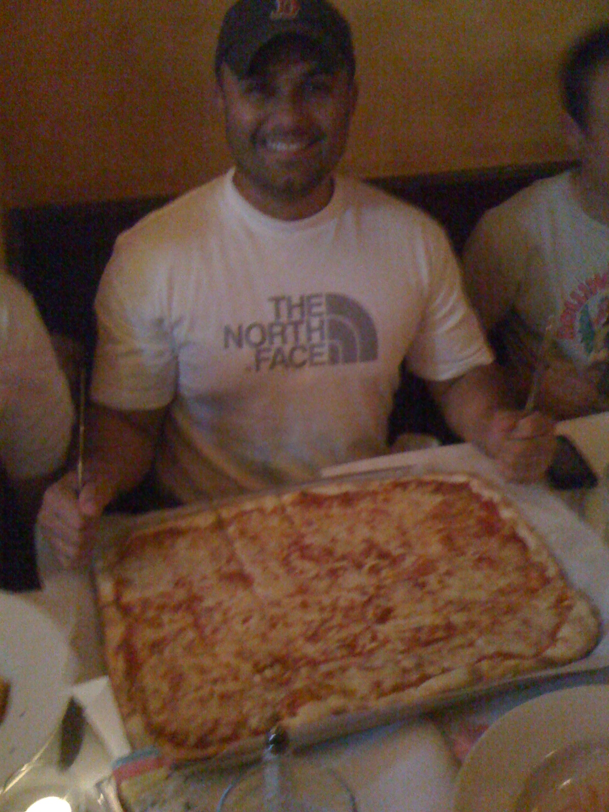 Thieu orders a HUGE pizza, the cornerstone of a world-class athlete's diet!