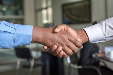 Two men shaking hands, agreeing on the contract