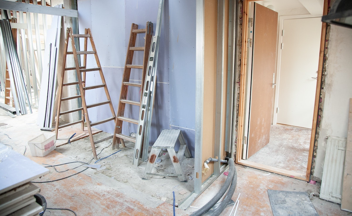 A picture of a room that's being renovated. With lumber prices in 2021 being so high and spending more time indoors, many people are turning to improving their own houses.