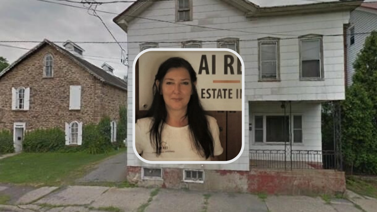 Woman in front of old house